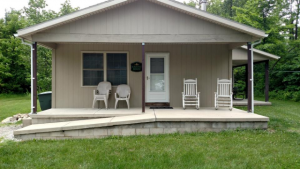 Habitat House sleeps up to four people in 2 bedrooms: 1 with a Queen sized bed, and 1 with a Full sized bed. Habitat includes a great room with living area, dining area, and kitchen.